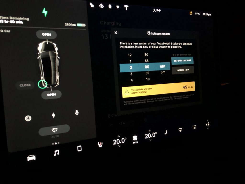 Tesla Model 3 screen showing a scheduled update