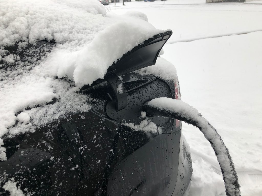 Tesla Model 3 - Charging in snow covered wall charger