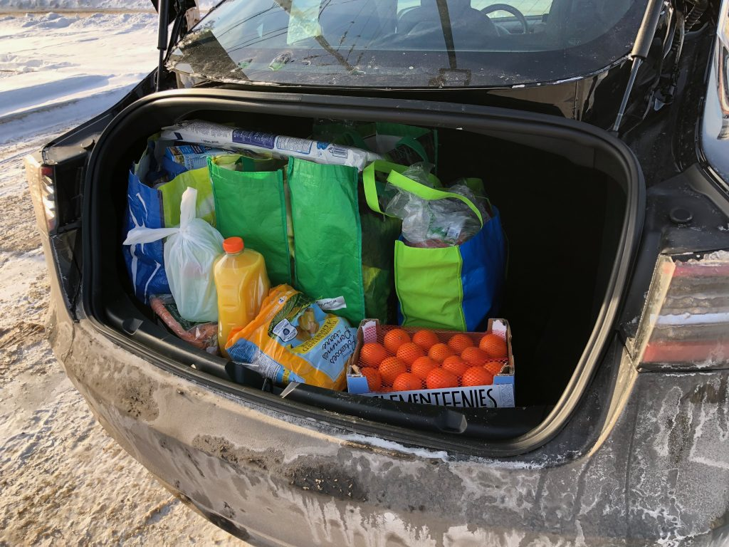 Tesla Model 3 trunk with groceries